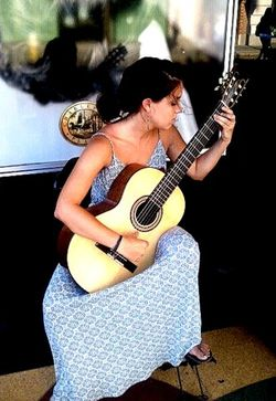 Grace McNally classical guitarist to play 2nd Sunday