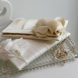 Nelle Classic Flutter Clutches available at Lily Charleston the perfect wedding accessory